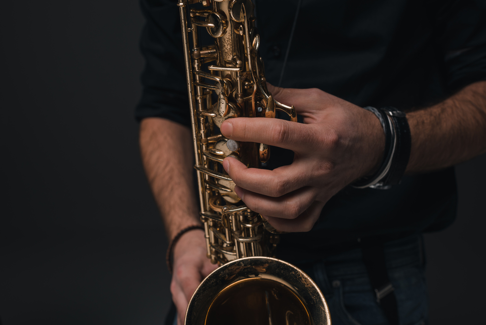 cropped shot of jazz musician playing saxophone